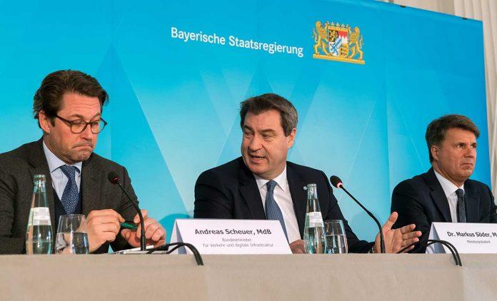 Andreas Scheuer, Marcus Söder und Harald Krüger (v.l.) . Foto: dpa