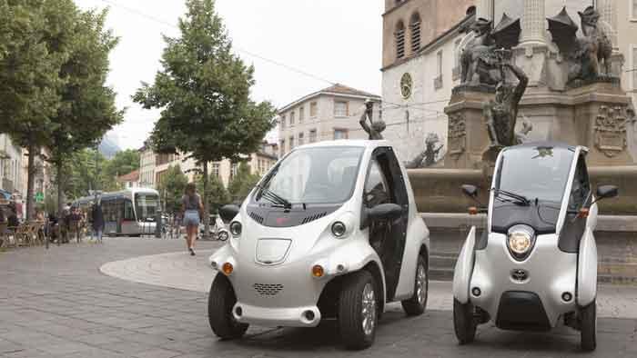 70 Toyota COMS (li.) und i-Road sind demnächst in Grenoble unterwegs.